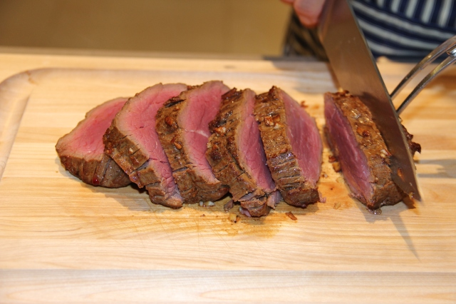To serve, remove the strings and carve the beef on a chopping board.