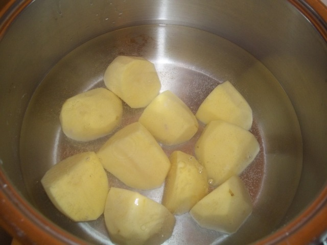 Preheat oven to 200 degrees. Parboil the potatoes.