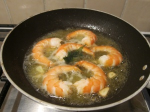 Peel the prawns and cook them in a frying pan with olive oil. Add some white wine,  1/2 garlic and a bit of parsley.